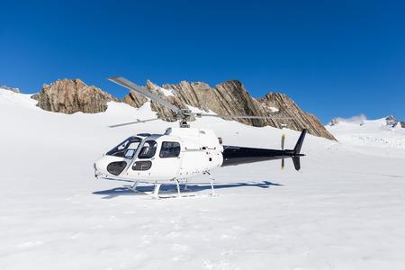 josef: helicopter landing on snow at Franz Josef Glacier, New Zealand Stock Photo