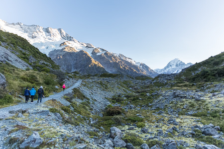 mountaintops: tourists walking at Kea Point track trail with the view of mount cook and mountaintops