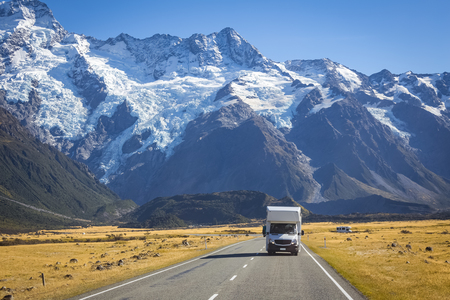 campervan on road with Mount Cook view background, New Zealand