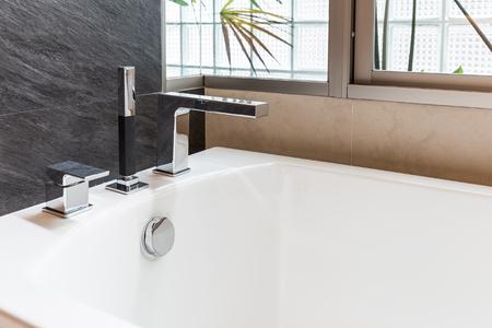 closeup faucet of bathtub in bathroom Stock Photo