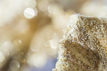 shining golden snowflake decoration with bokeh background Stock Photo