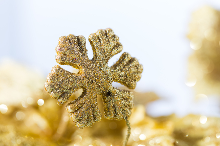 shining golden snowflake decoration with bokeh background Stock Photo