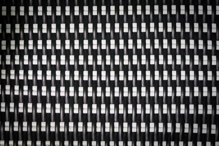 latticework: closeup black and white weave texture of furniture Stock Photo