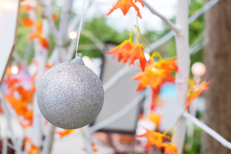 silver christmas ball decorated on maple tree