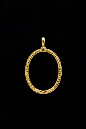 gold locket frame pendant on black background Stock Photo