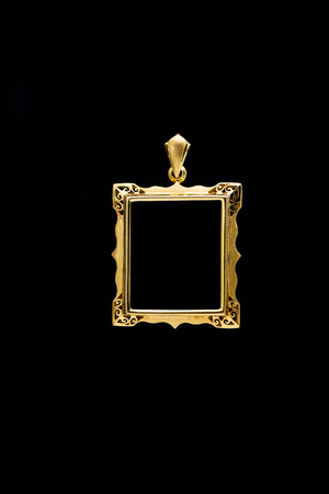 gold locket frame pendant on black background Stock Photo