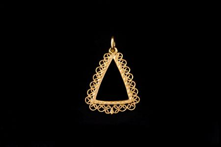 inlay: triangle shape gold locket frame pendant on black background Stock Photo