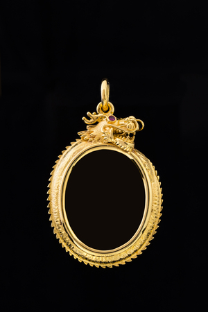 gold locket dragon frame pendant on black background