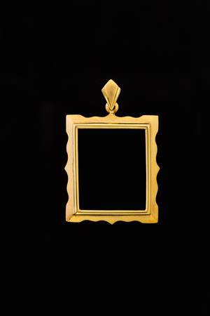 rectangle shape gold locket frame pendant on black background Stock Photo