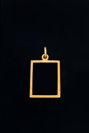 rectangle shape gold locket frame pendant on black background Stock Photo