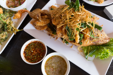 deep fried seabass topped with lemon grass and two styled spicy dips