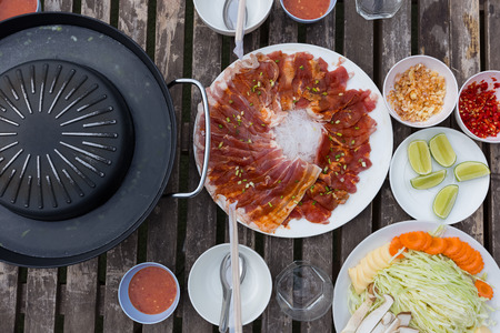 Thai styled pork barbecue set on wood table