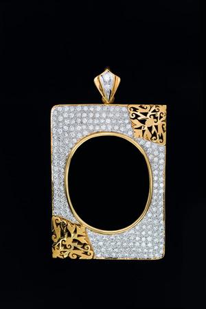 gold rectangle shape locket frame pendant with diamond on black background
