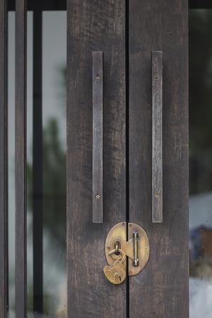 closed wood door with unlock classic key Stock Photo