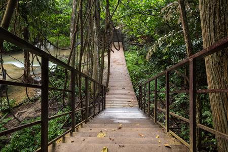 khamin: wooden walkway in jungle, Huay Mae Khamin waterfall, Thailand Stock Photo
