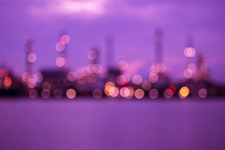 colorful bokeh from blurred oil refinery plant at dawn Stock Photo