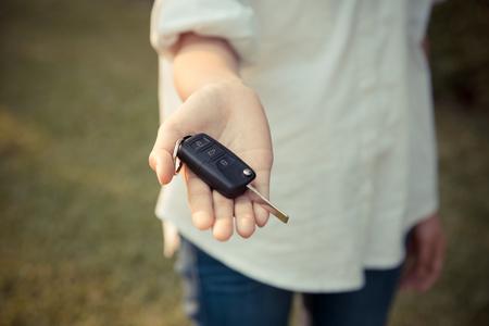 woman holding car remote key, automobile sales agent concept Stock Photo