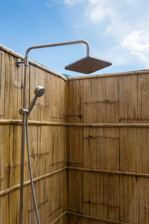 closeup outdoor shower with bamboo wall