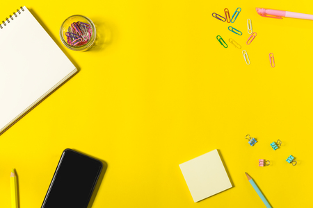 flat lay stationary on yellow background with copy space, office and education concept