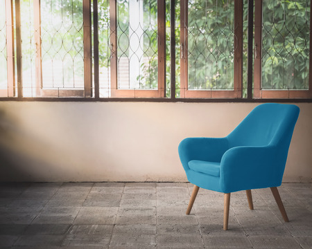 blue chair decorated in vintage style room Standard-Bild - 116415850