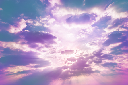sun behind cloud with rays in pastel sky Standard-Bild - 116415854