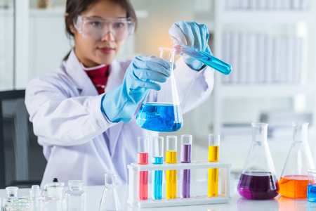 laboratory research and development concept by female scientist with lab glassware Stockfoto