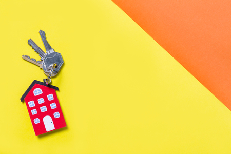 colorful home keys on yellow background, concepts for real estate and business