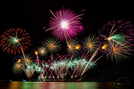 colorful fireworks from the sea at Pattaya, Thailand Фото со стока