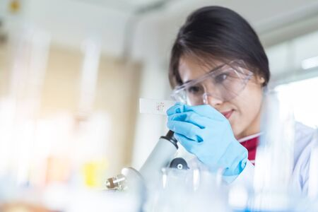 laboratory research and development concept with scientist and lab glassware 스톡 콘텐츠