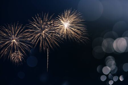 colorful fireworks with dark blue tone bokeh background, celebration concept