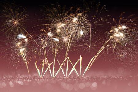 colorful fireworks on pink bokeh background, celebration concept