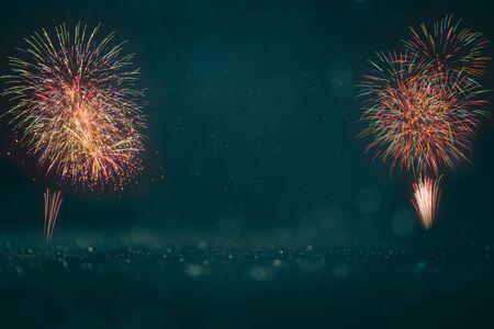 colorful fireworks on dark green bokeh background, celebration concept