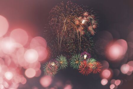 colorful fireworks on pink bokeh background