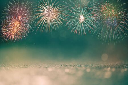 colorful fireworks on green bokeh background, celebration concept