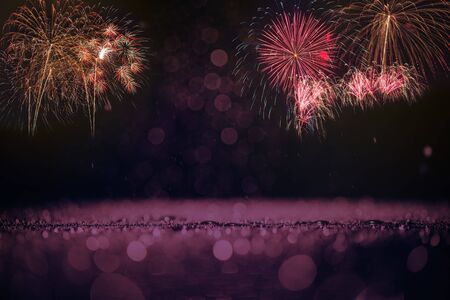 colorful fireworks with purple bokeh background, celebration concept