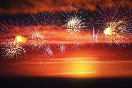 colorful fireworks display with sunset sky, celebration concept