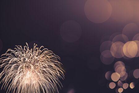 colorful fireworks with vintage tone bokeh background, celebration concept