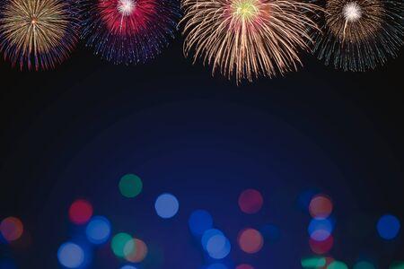 colorful fireworks with blue bokeh background, celebration concept Banco de Imagens