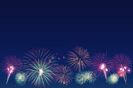 colorful fireworks on dark blue background, celebration concept