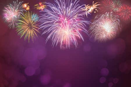 colorful fireworks celebration on pink bokeh background Standard-Bild
