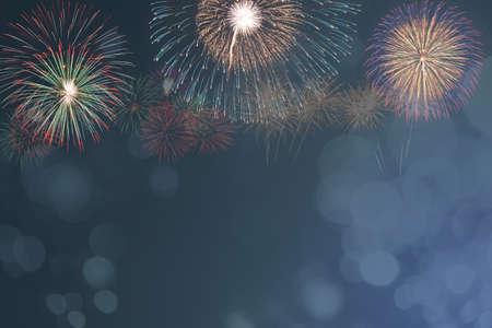 colorful fireworks celebration on blue bokeh background