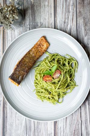 pesto spaghetti with salmon steak, healthy food