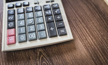 closeup part of calculator on wood table background