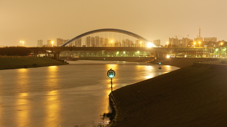 Bridge in front of a city Stock Photo