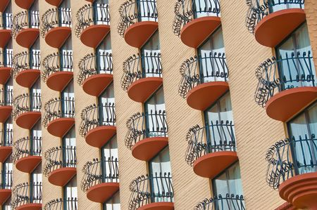Repetitive window balcony with iron fence