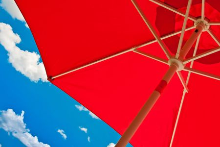 lon: Red umbrella for shading for shading lon a blacony