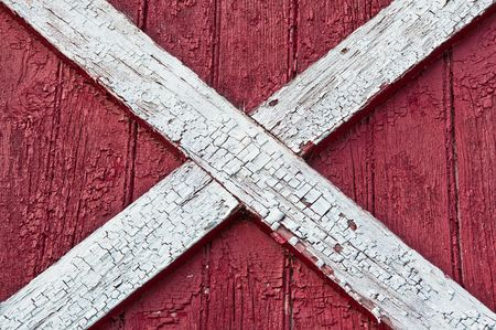 Wall of red barn wood surface photo