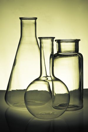 Backlit Chemistry Flasks and Glassware on a Table