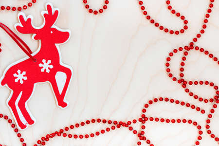 Christmas composition with deer and red bow on wooden background. Top view image with copy space 版權商用圖片