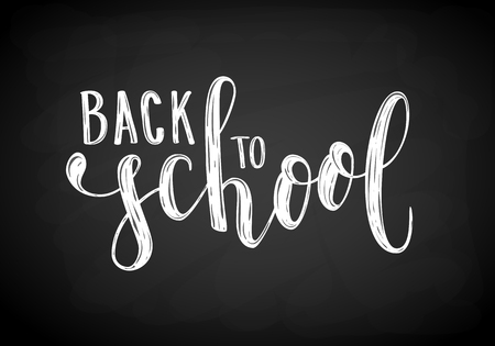 Back to school. Hand drawn brush pen lettering on black chalkboard. design for holiday greeting card and invitation, flyers, posters, banner